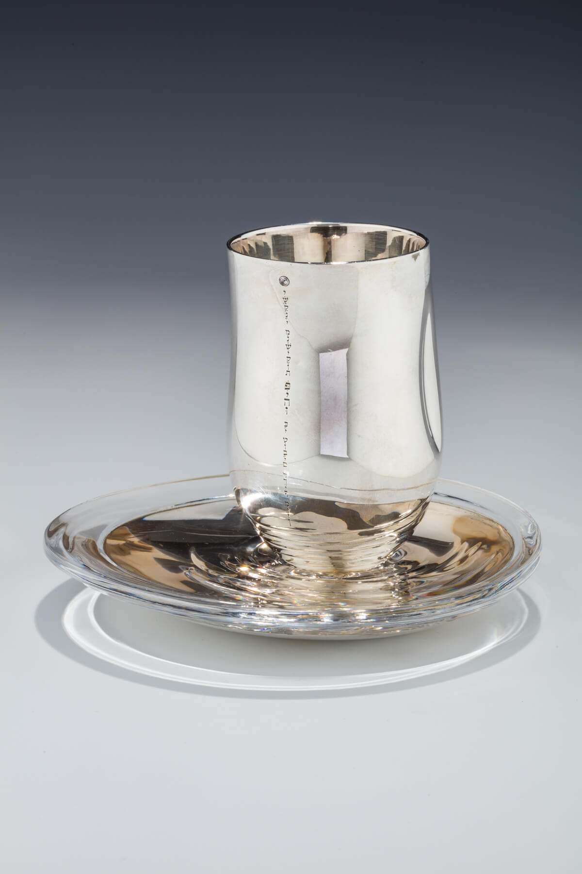 112. A Sterling Silver and Diamond-Encrusted Kiddush Cup and Underplate by Anvehu