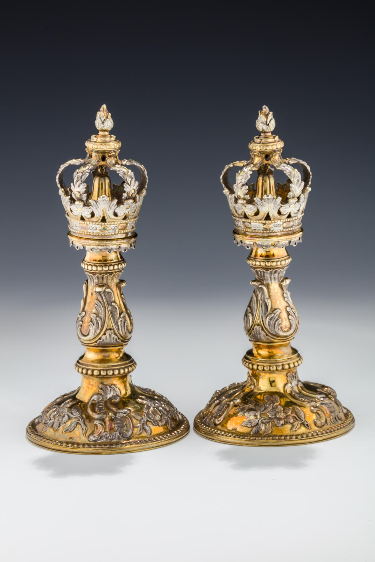 099. A Pair of Important Gilded Silver Torah Finials