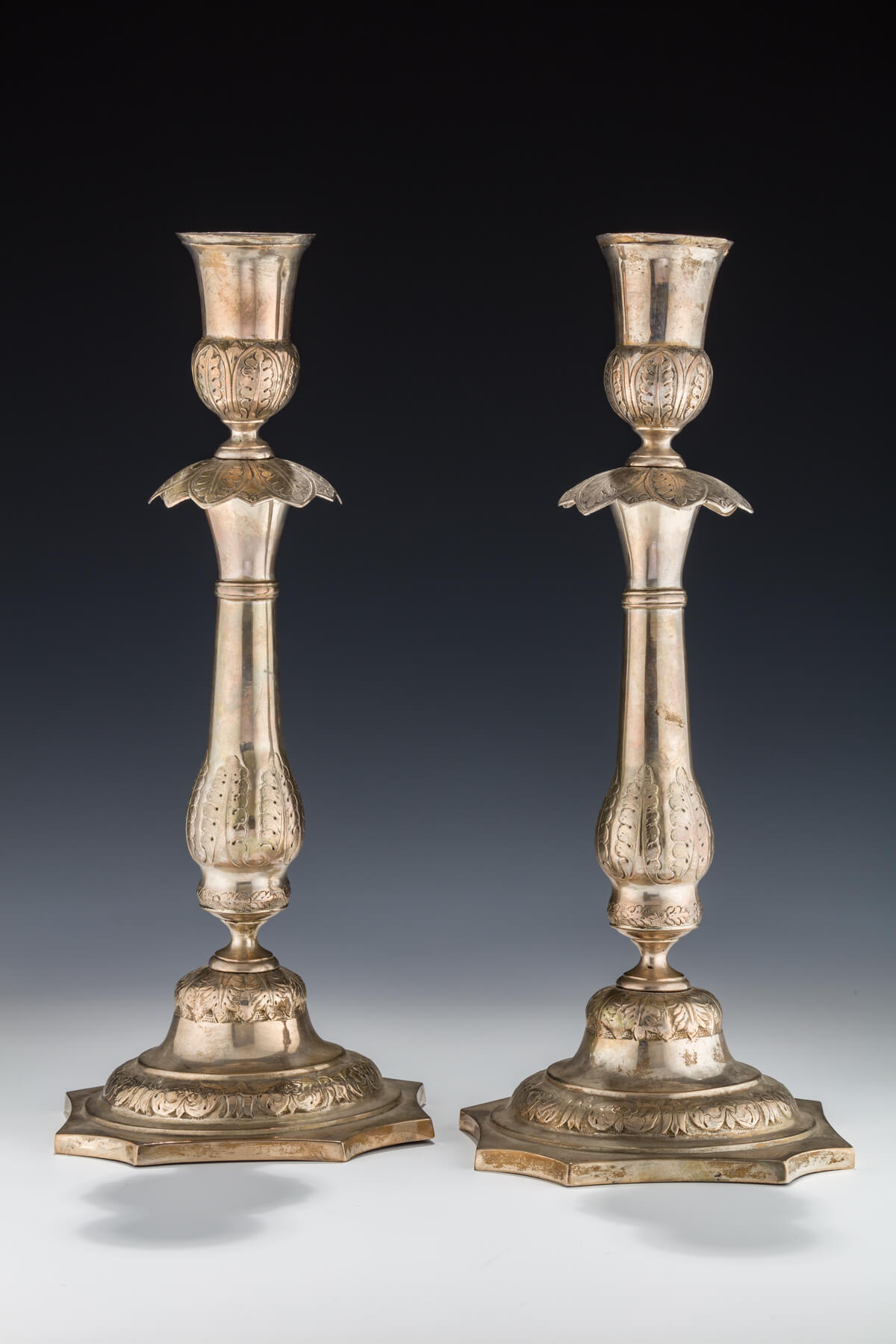 010. A Pair of Large Silver Candlesticks