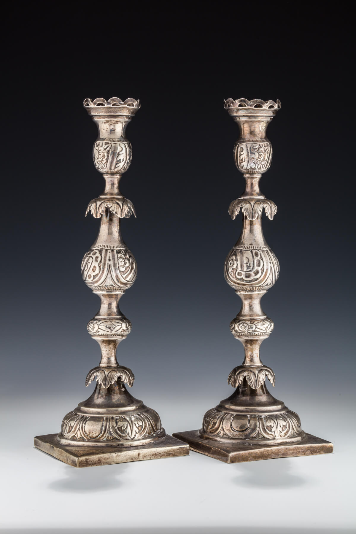 008. A Pair of Large Silver Candlesticks by Shmuel Skarlat