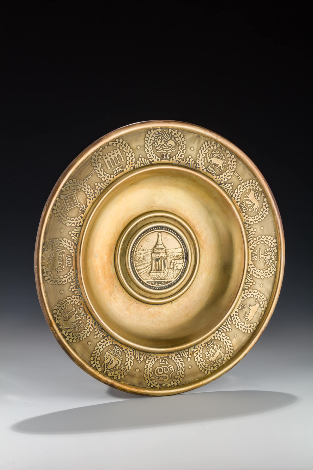 086. A Large Brass Decorative Dish by Bezalel