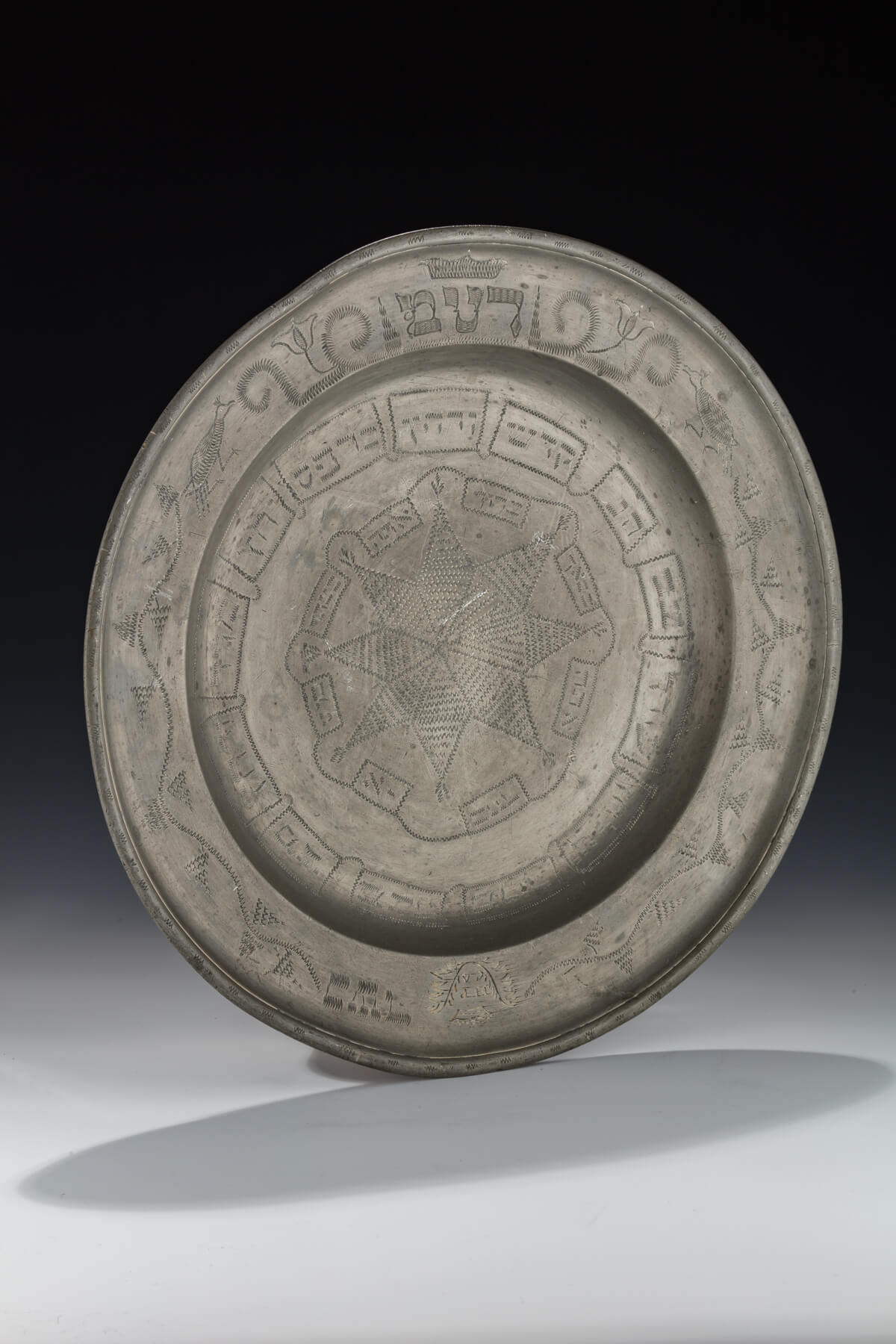 073. A Monumental Pewter Passover Seder Dish