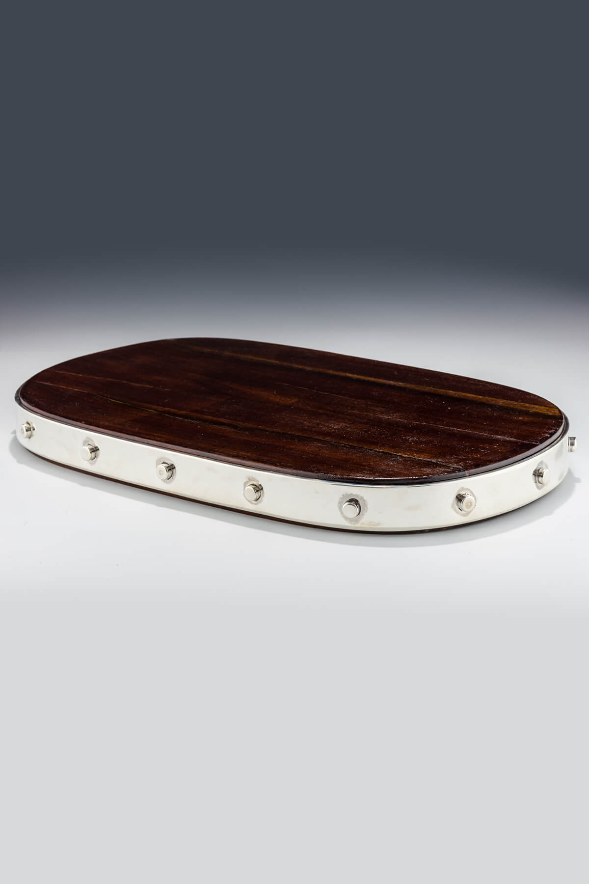 142. A Sterling Silver and Wood Challah Board by Arie Ofir