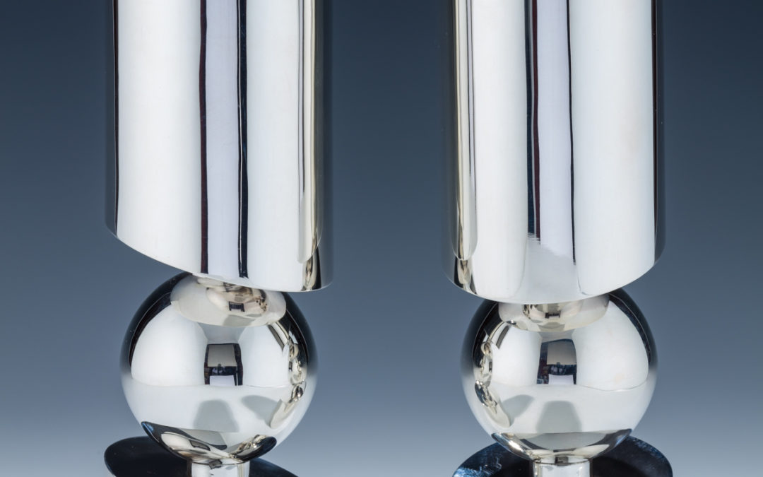 136. A Pair of Sterling Silver Candlesticks by Carmel Shabi