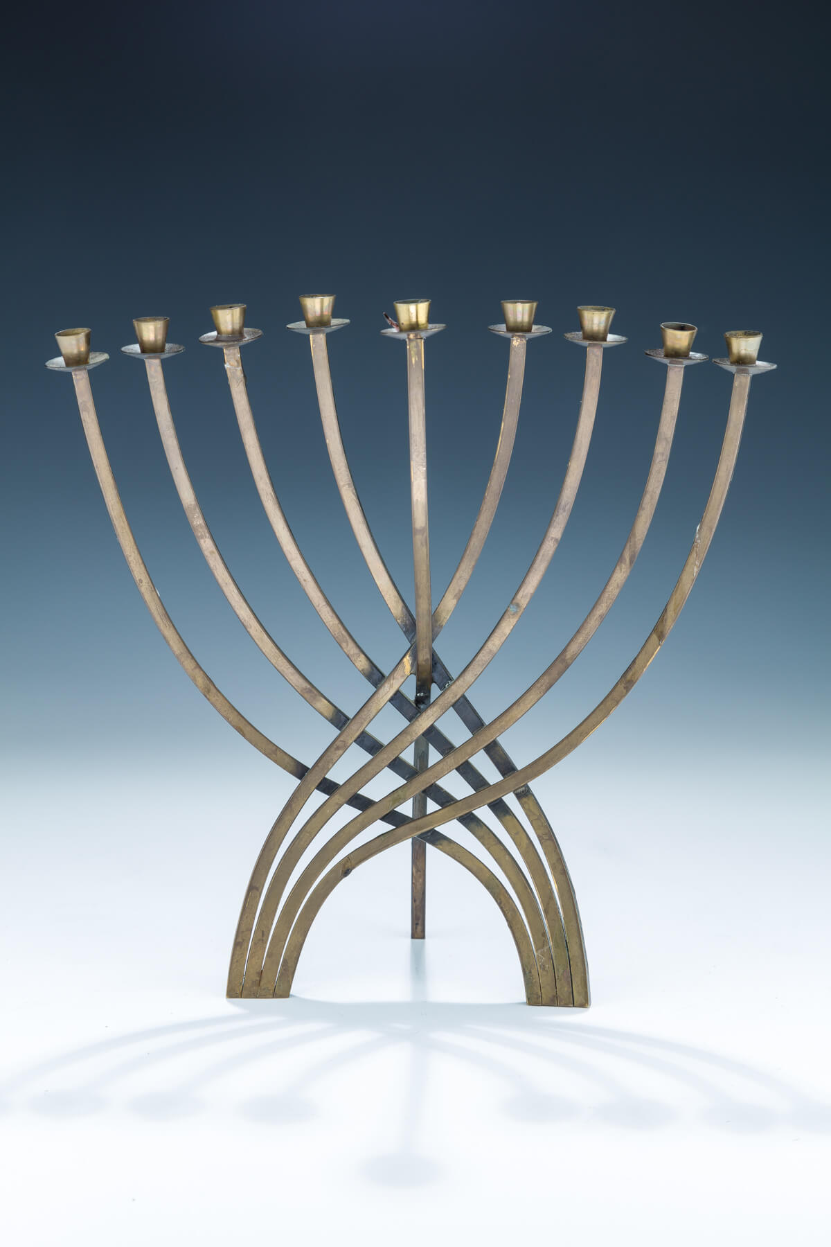 139. A Brass Chanukah Menorah by Ludwig Wolpert