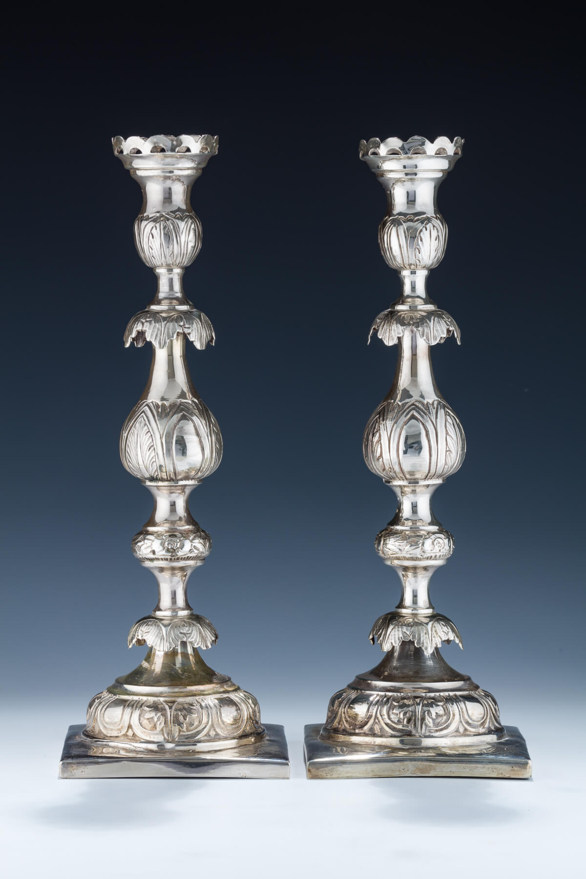 8. A Pair of Large Silver Candlesticks by Shmuel Skarlat
