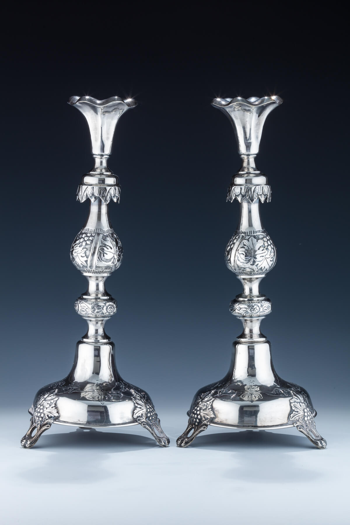 37. A Large Pair of Silver Candlesticks by Shmuel Skarlat