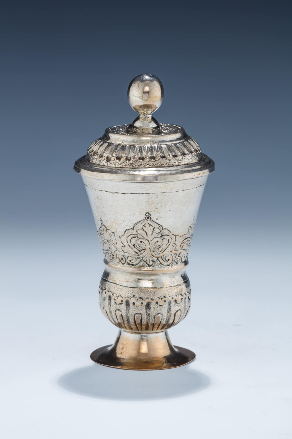 61. An Early Silver Covered Kiddush Beaker