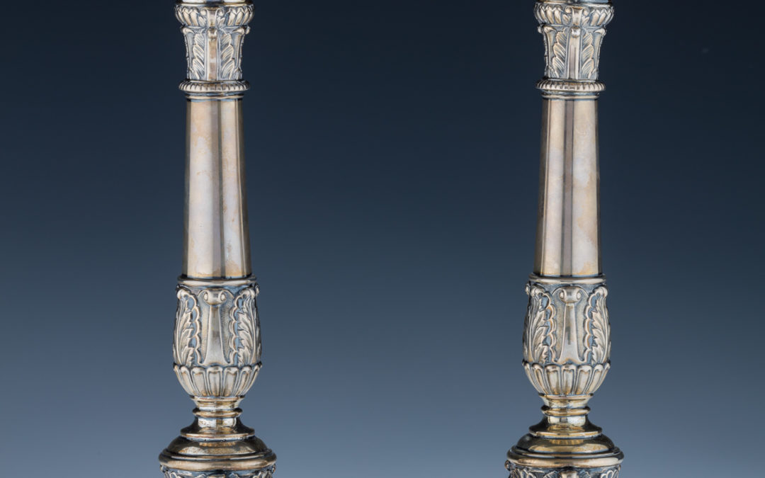 16. A Pair of Silver Candlesticks
