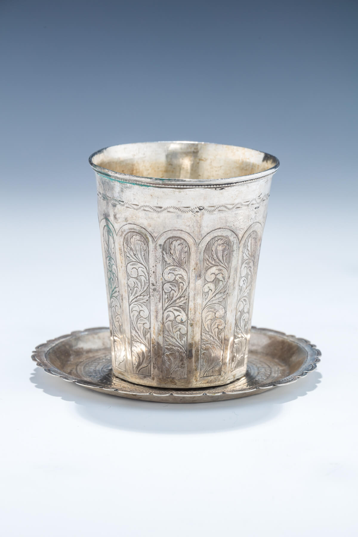 67. A Silver Kiddush Cup And Underplate