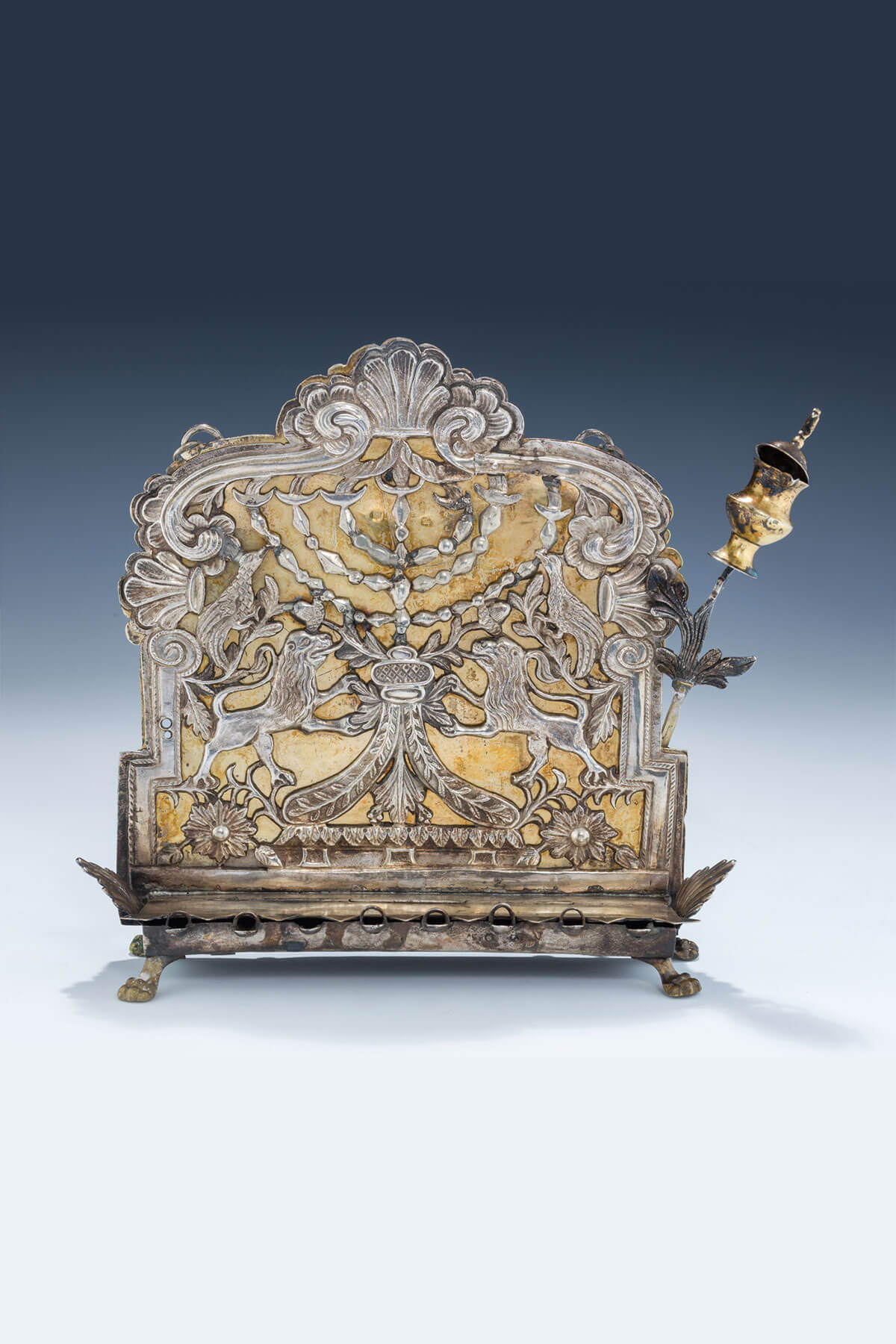 116. A Rare And Early Parcel Gilt Chanukah Lamp