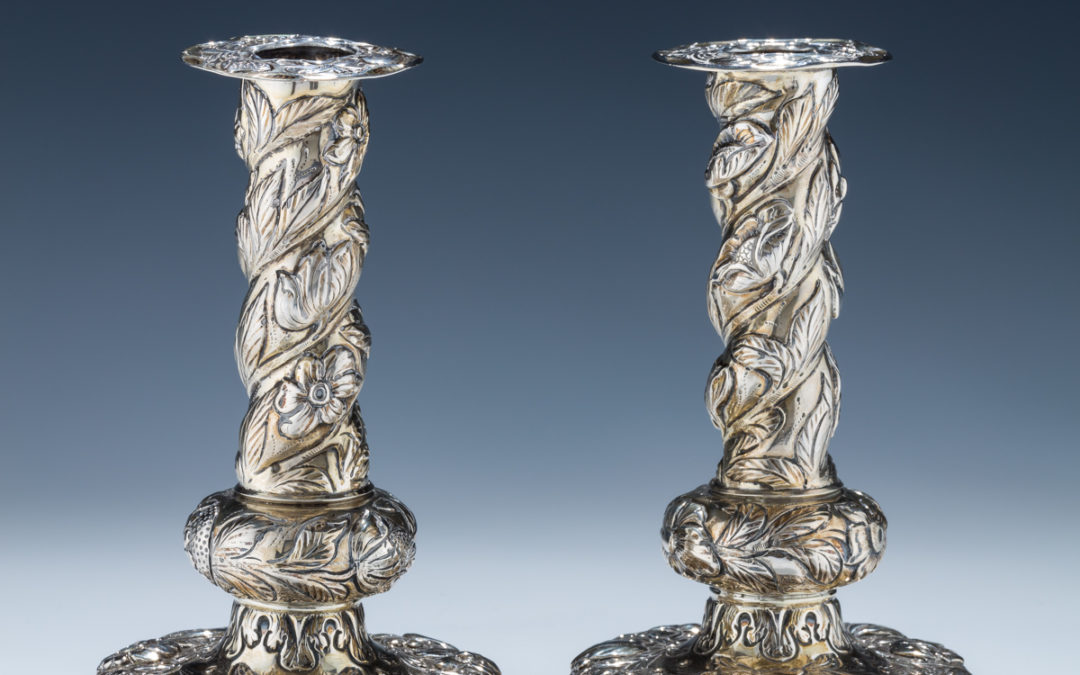 12. A Pair of Silver Candlesticks