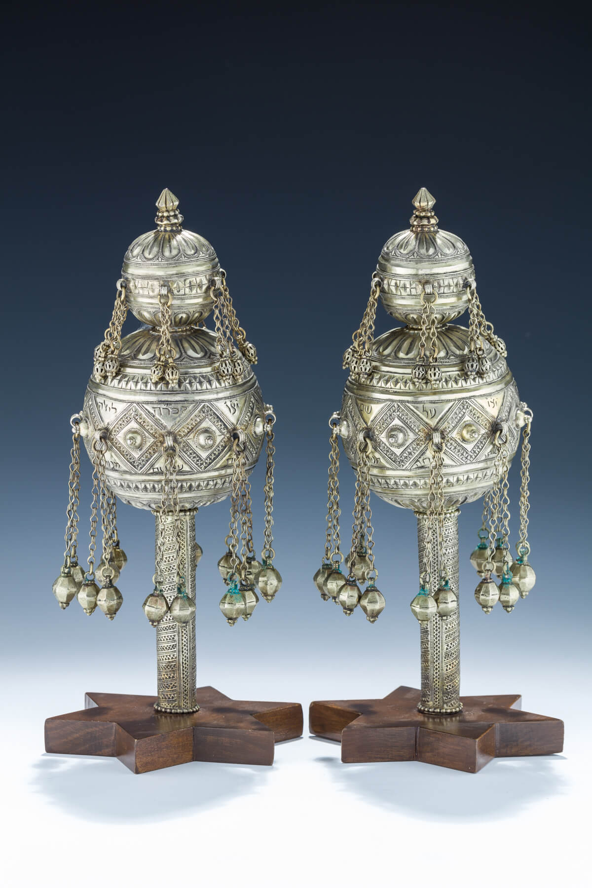 123. A Pair of Parcel Gilt Torah Finials