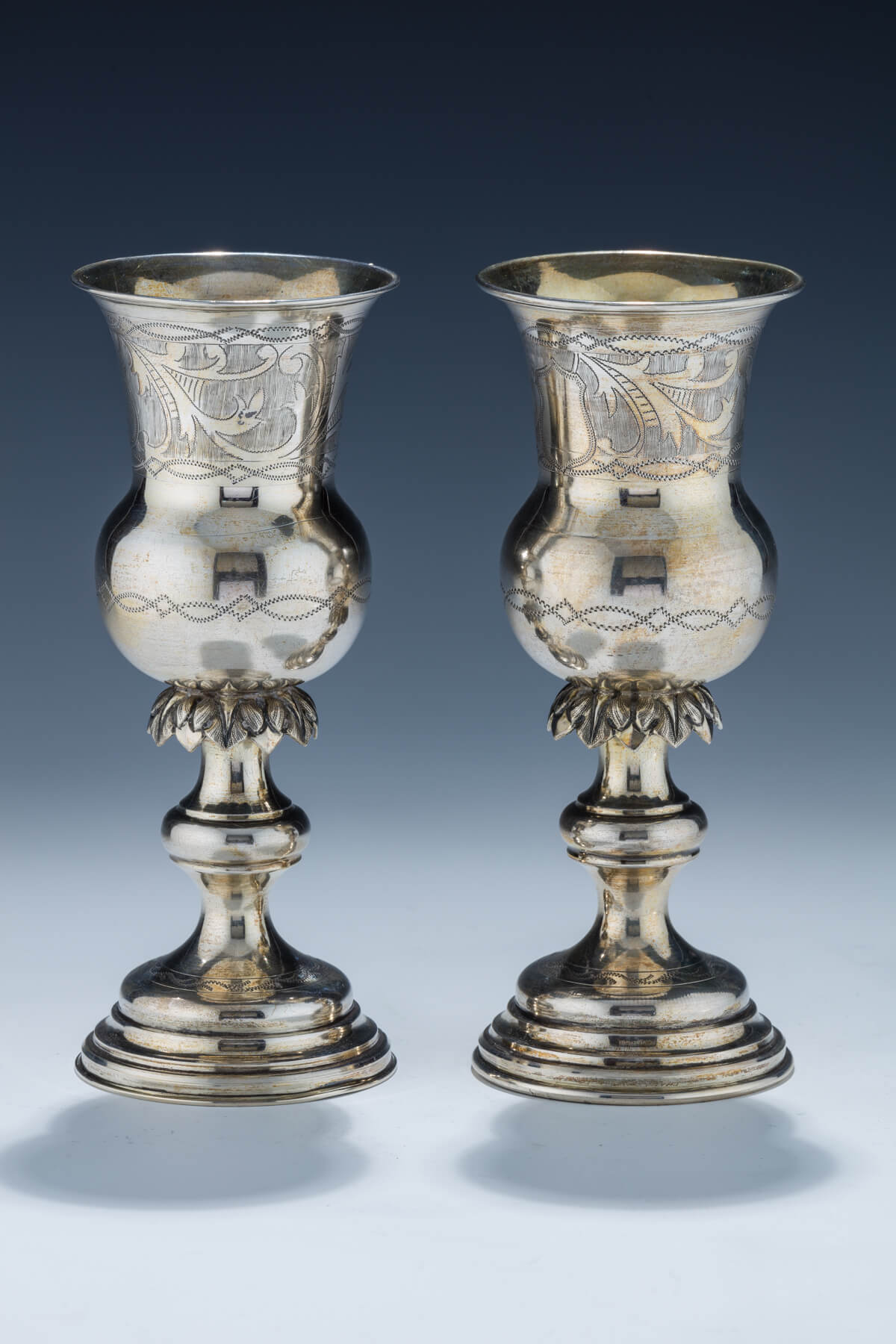 45. A Pair of Early Silver Kiddush Cups by Isaac Goldman