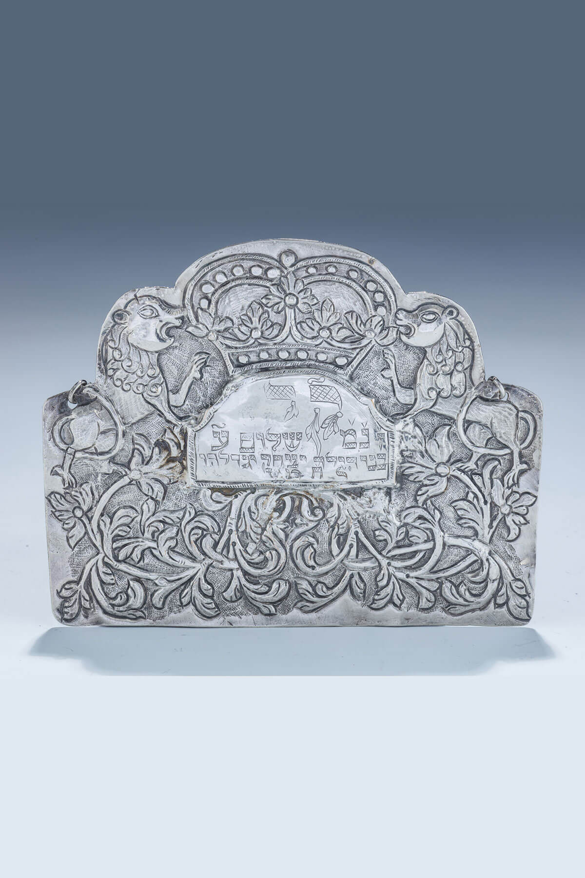 111. An Early Silver Torah Shield