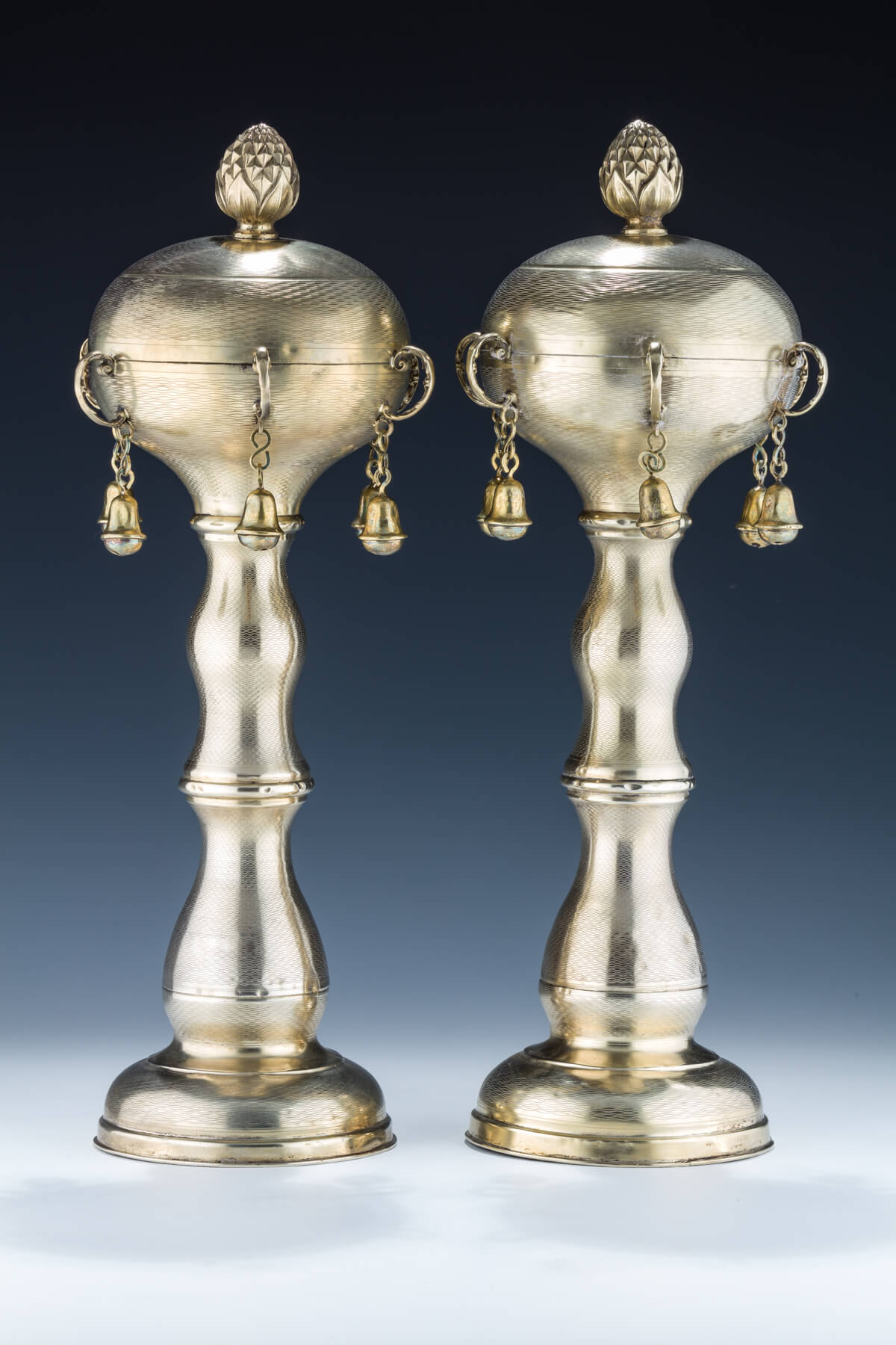 104. A Monumental Pair of Gilded Silver Torah Finials