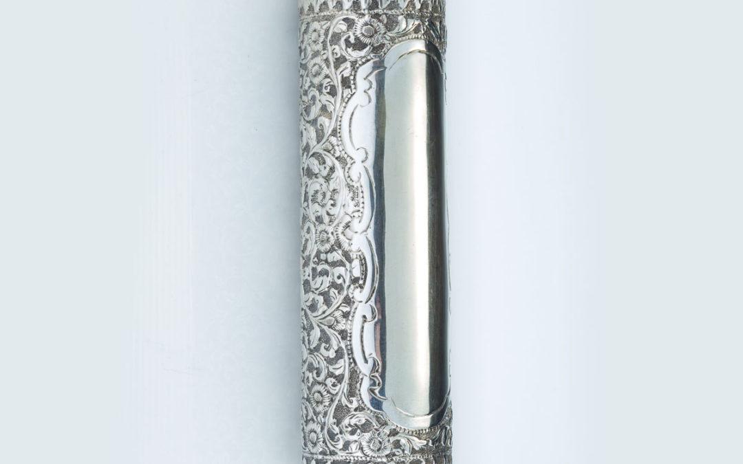 55. A Large Megillah in a Silver Case