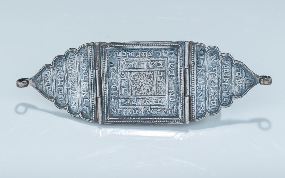 43. An Early Silver Amulet