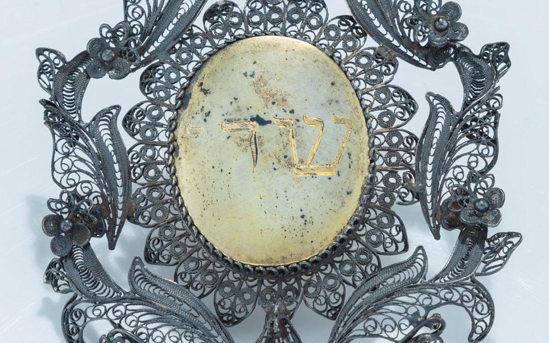 58. A Silver Amulet
