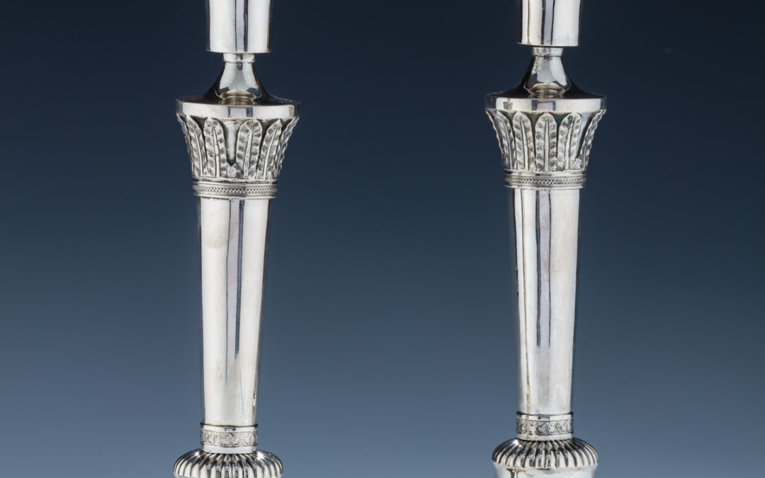 42. An Early Pair of Silver Candlesticks