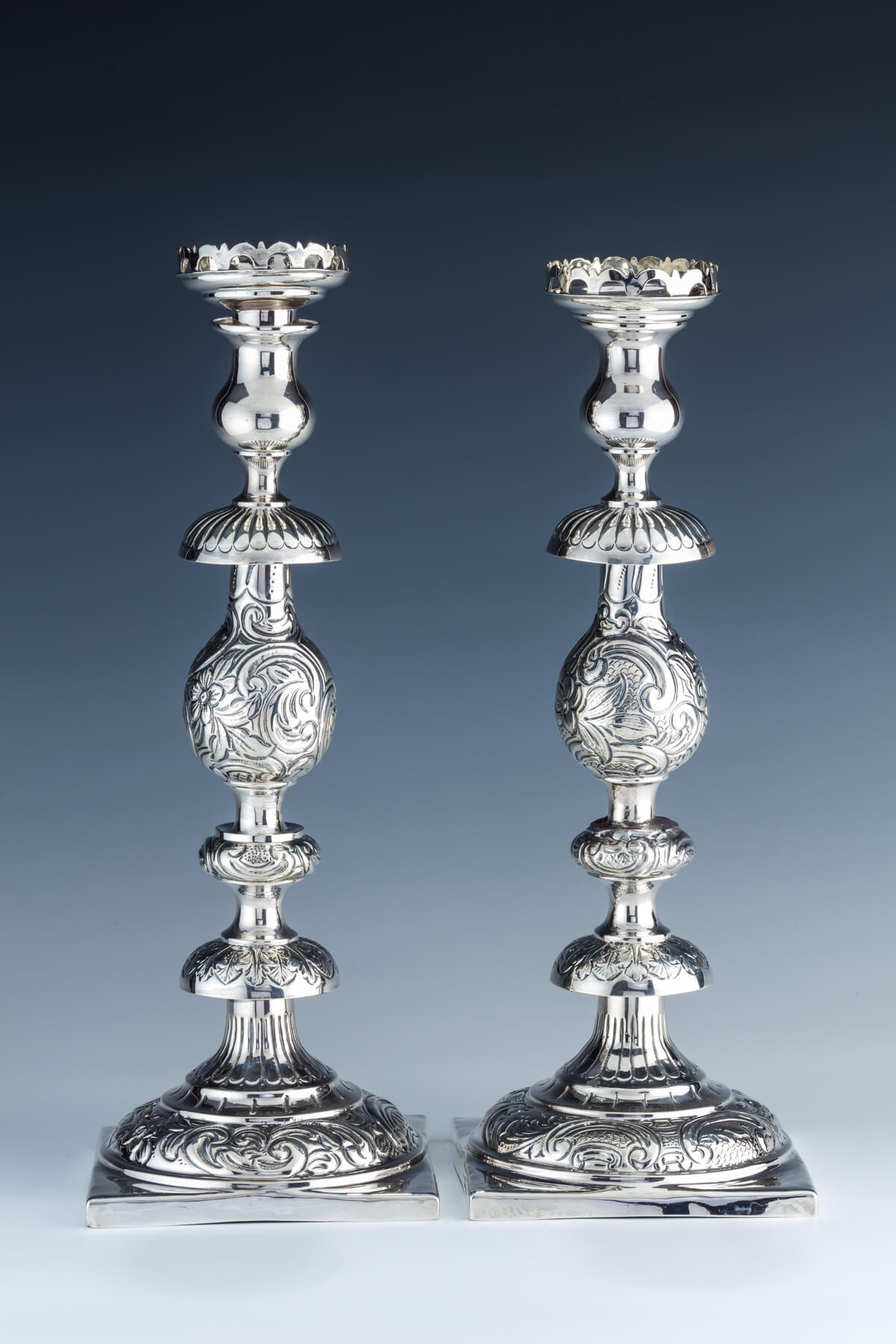 2. A Pair Of Sterling Silver Candlesticks By Alfred Fuller