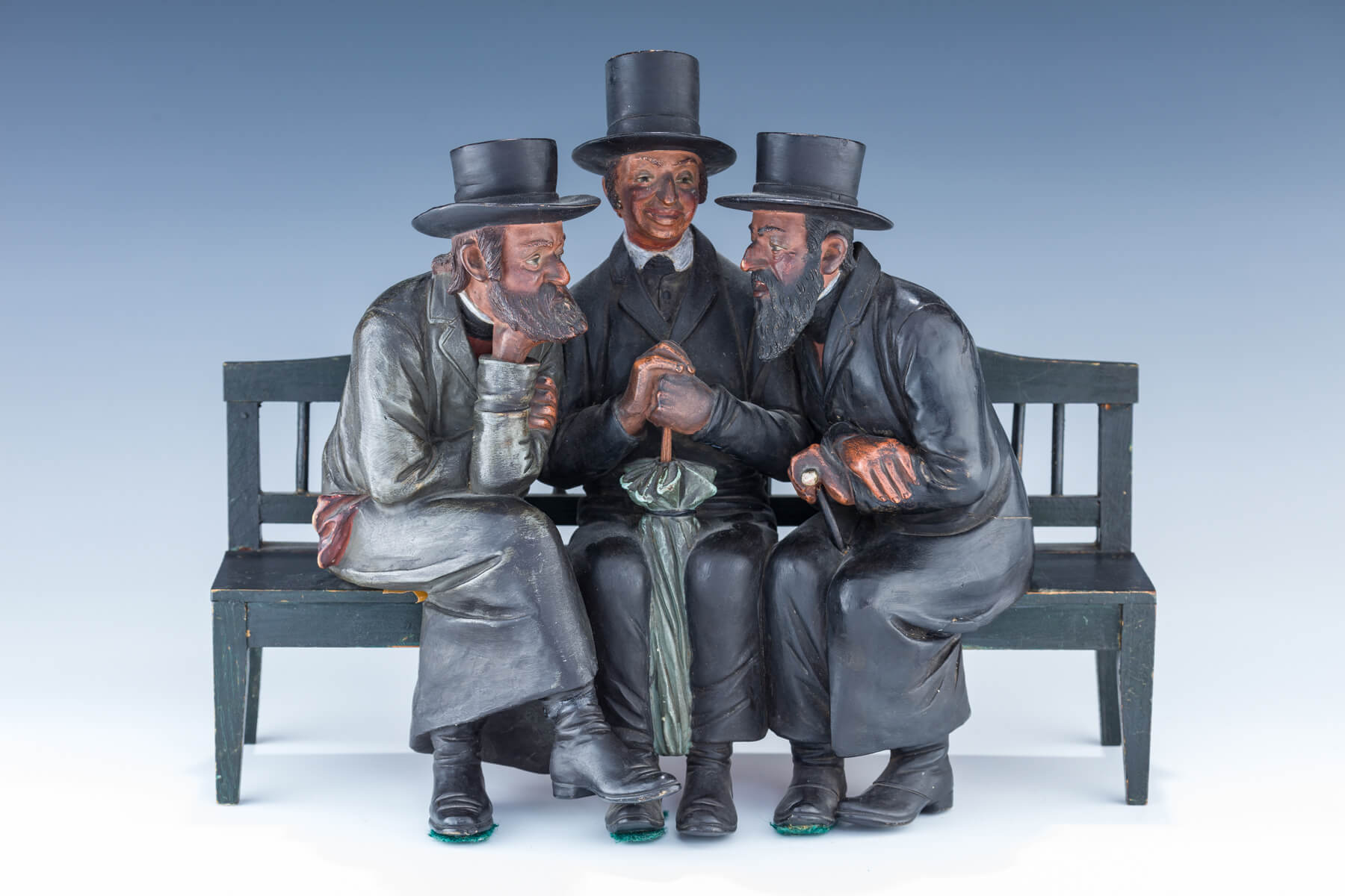 30. A Plaster Sculpture Of Three Jews On A Bench