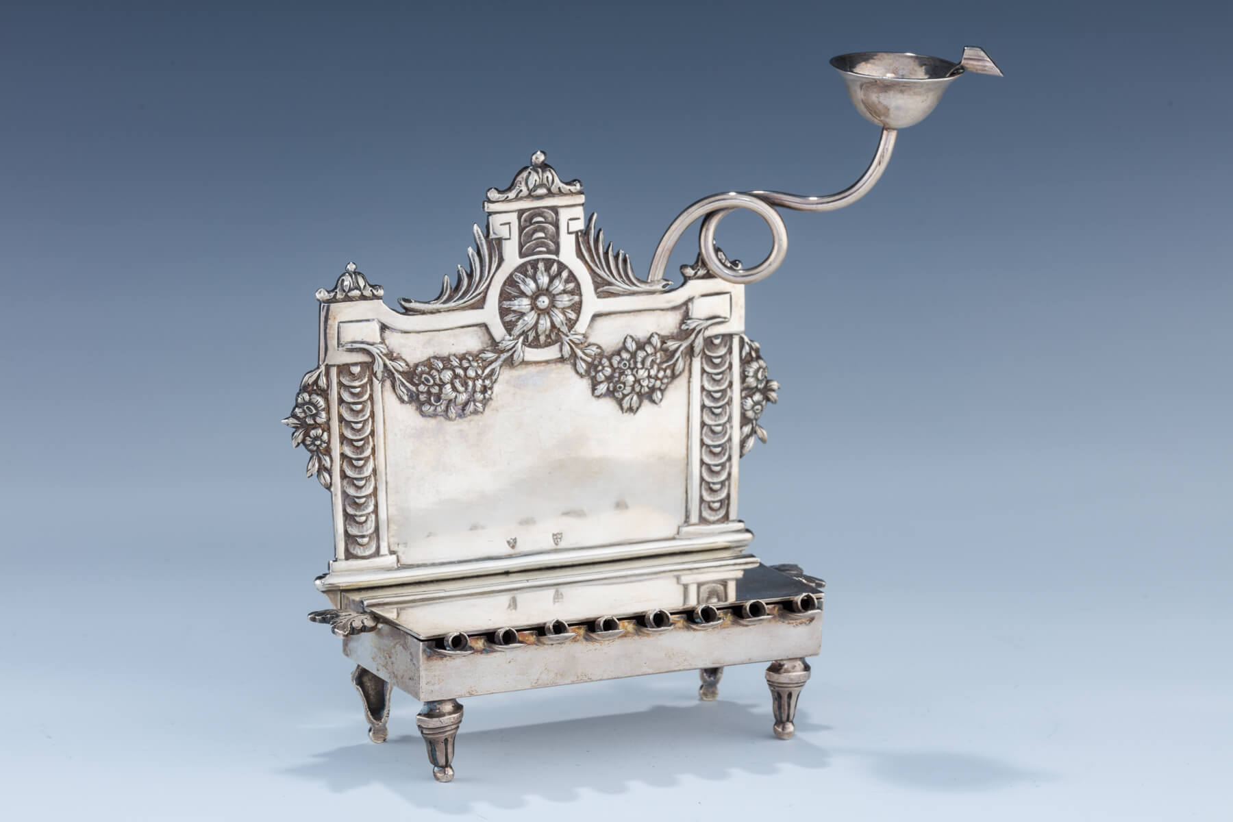 74. A Rare And Important Silver Hanukkah Lamp