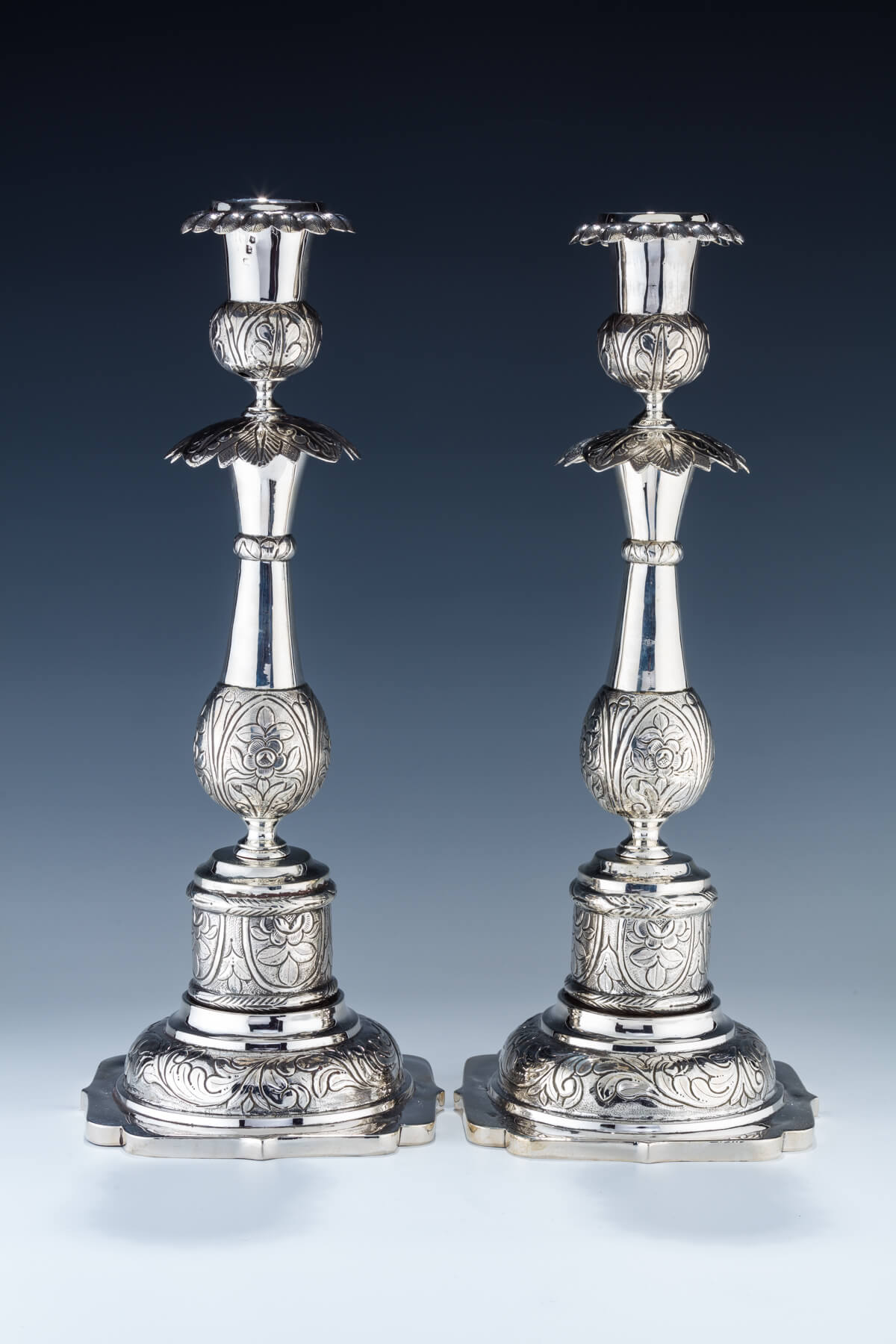 3. A Massive Pair Of Silver Candlesticks