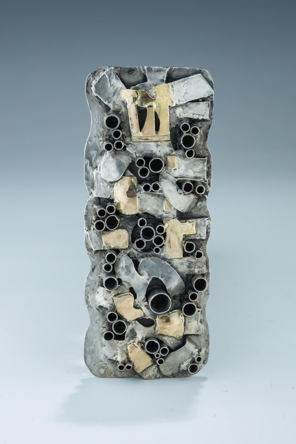 101. A Sterling Silver And Gold Mezuzah Case By Reisa Schor