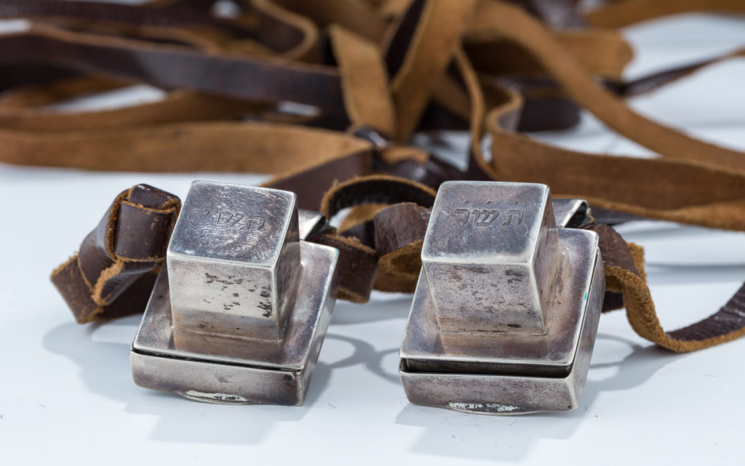 55. A Pair Of Miniature Tefillin With Early Silver Cases