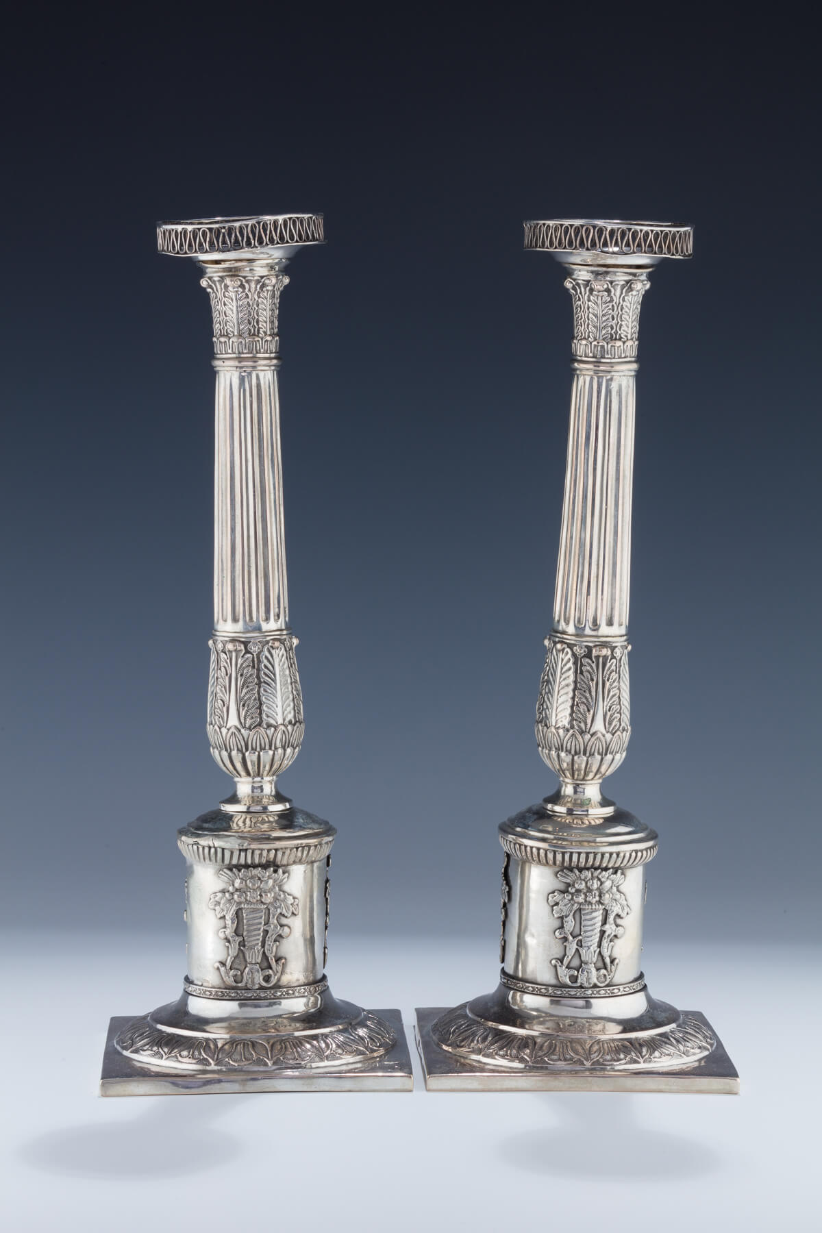 024. A Pair of Large Silver Candlesticks