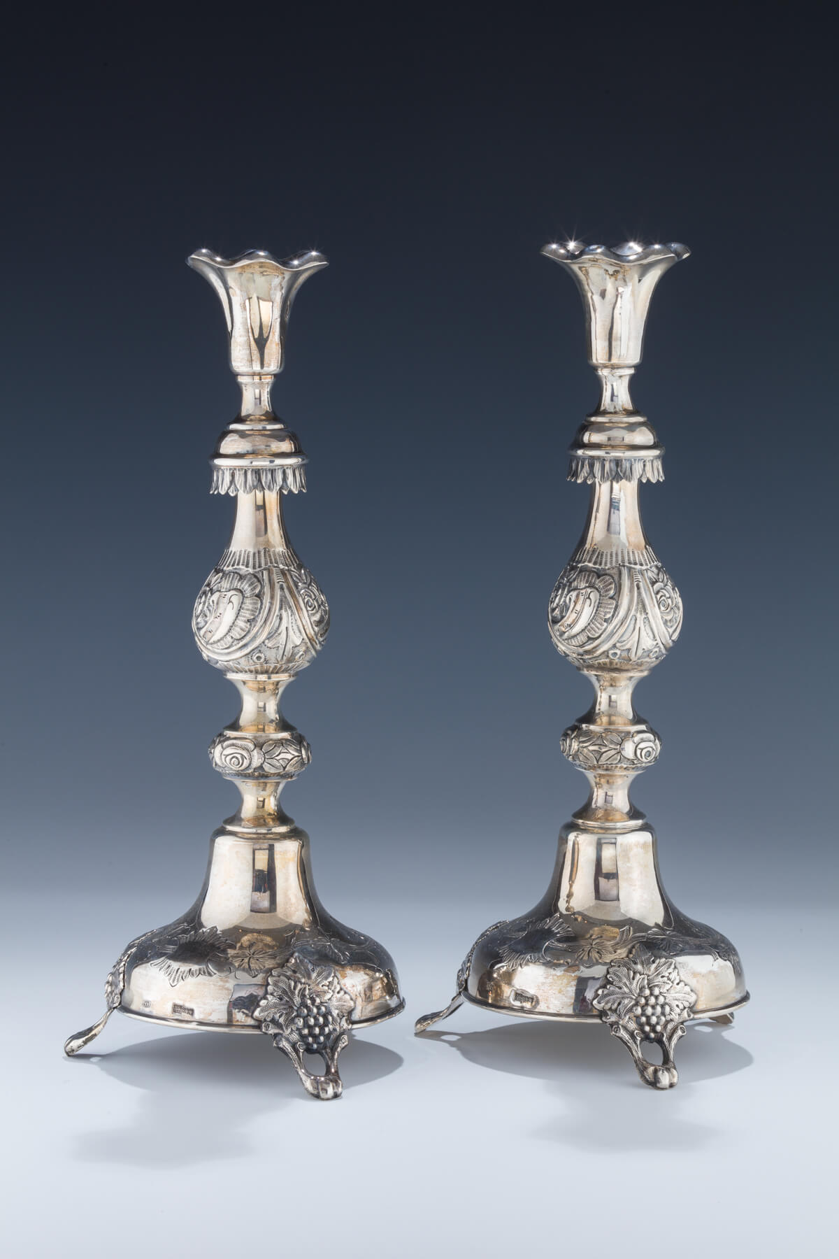 058. A Pair of Silver Candlesticks by Shmuel Skarlat