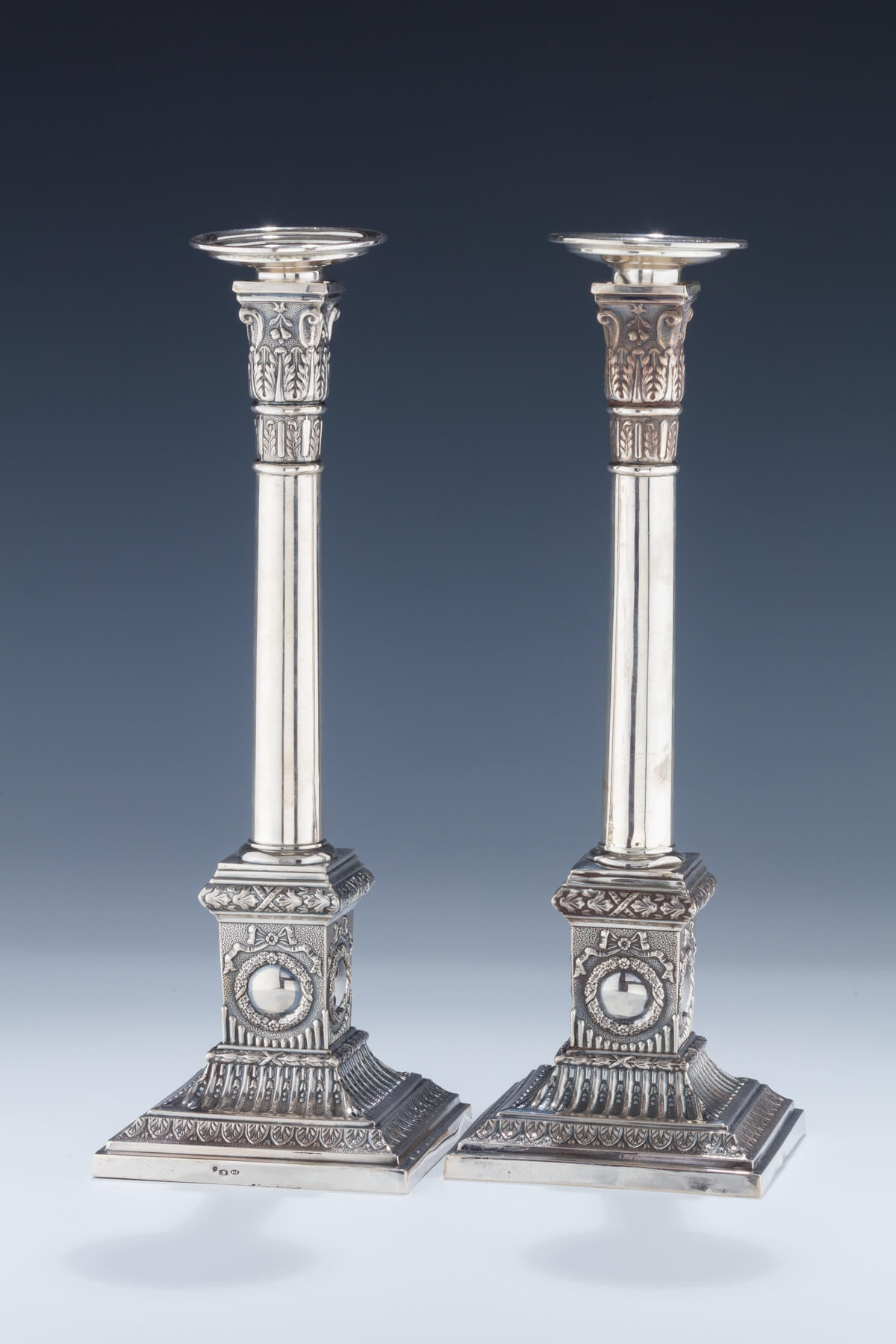 076. A Pair of Silver Candlesticks