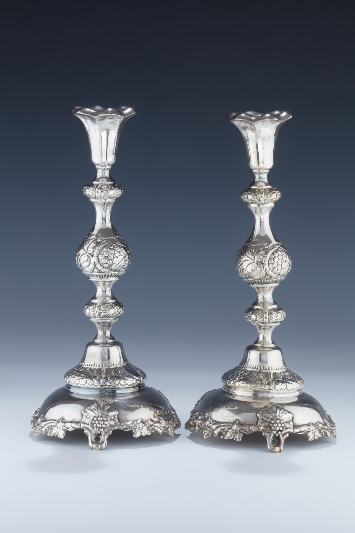001. A Pair of Large Silver Candlesticks