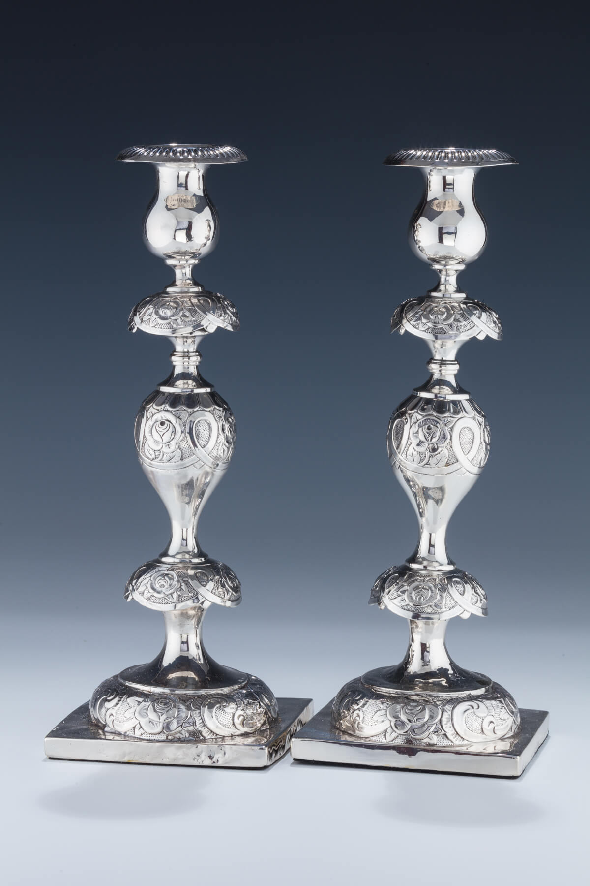 066. A Large Pair of Silver Sabbath Candlesticks by Swinarski