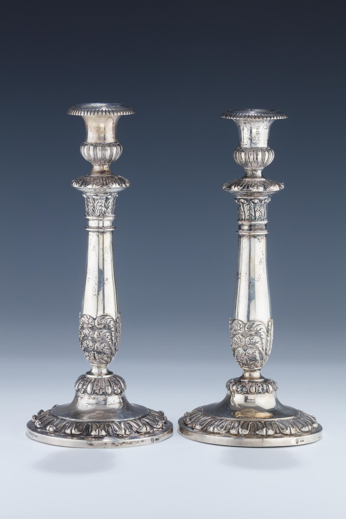 013. A Pair of Early Silver Candlesticks
