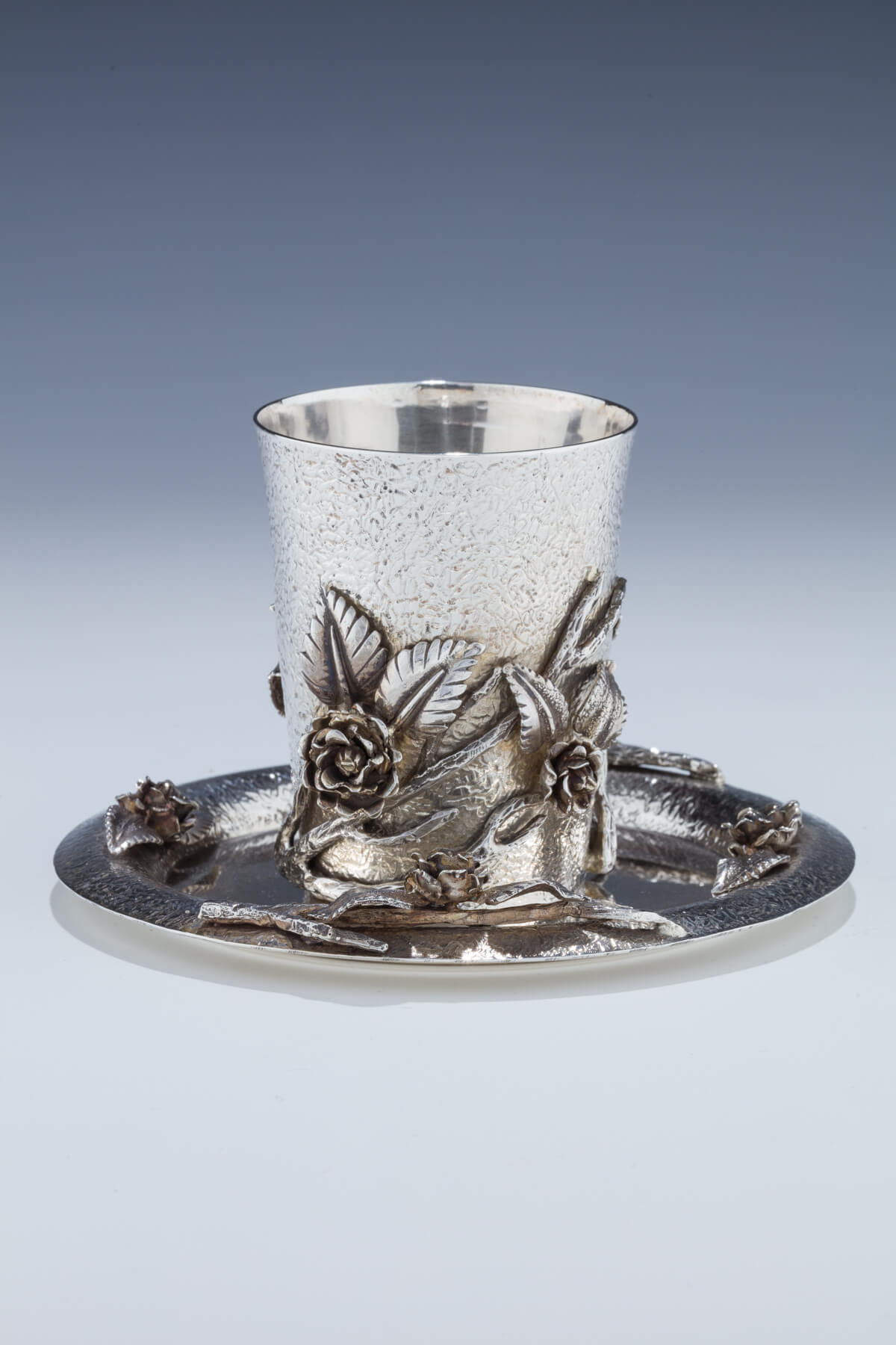 150. A Silver Kiddush Cup and Underplate by Hershel Pikkar