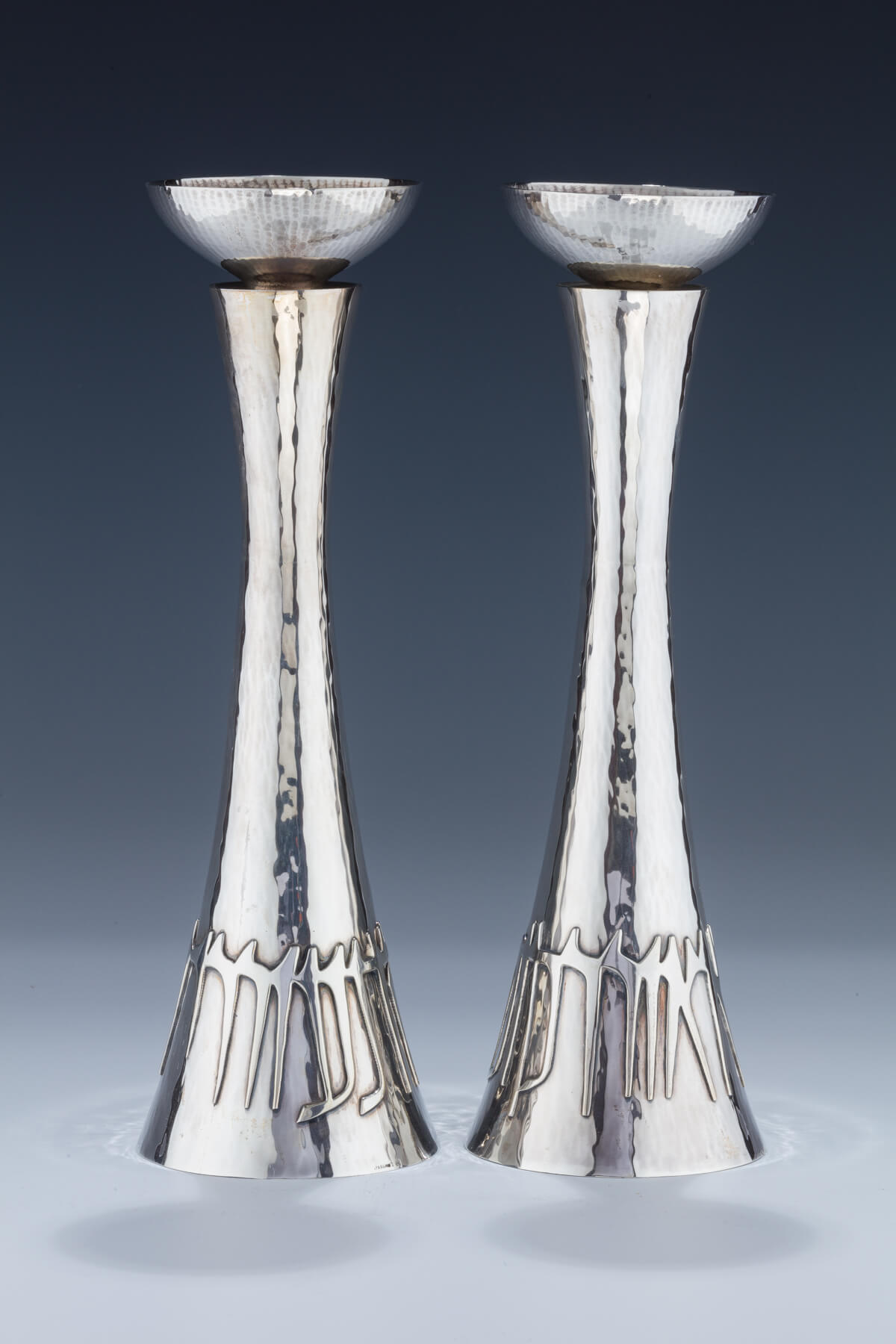 157. A Pair of Sterling Silver Candlesticks by Ludwig Wolpert