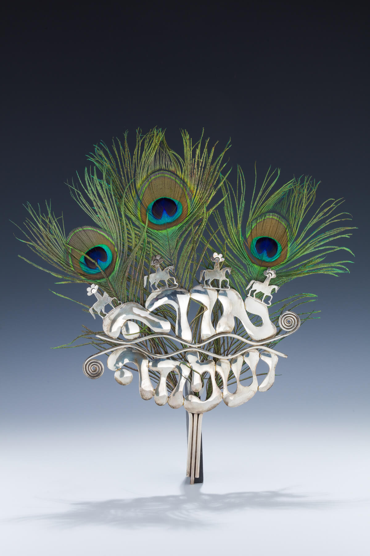 175. A Sterling Silver and Peacock Feather Purim Mask