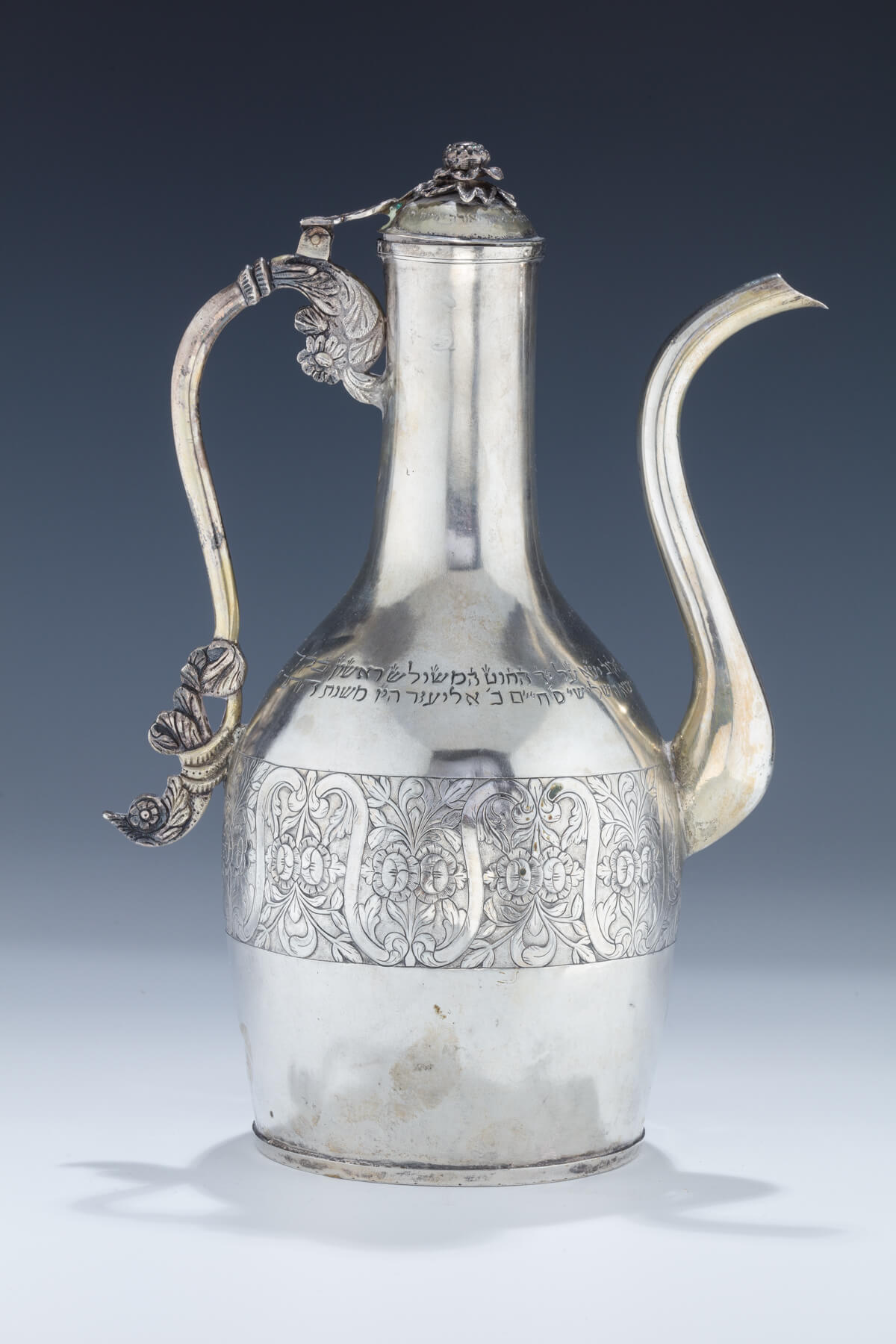 138. A Rare and Important Silver Decanter From a Beneficial Society