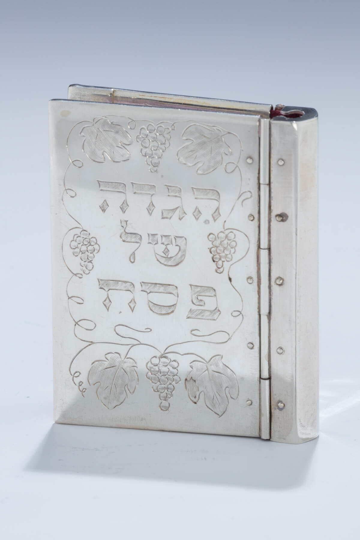 163. A Small Sterling Silver Bound Hagaddah by Shuki Freiman