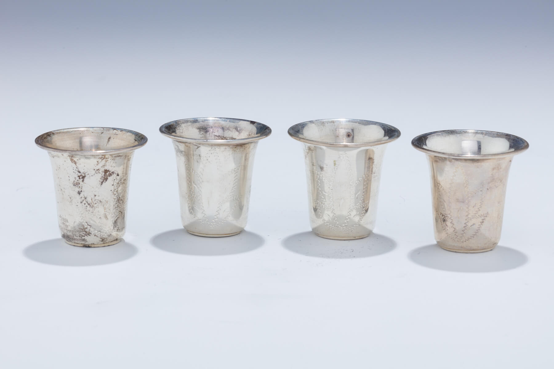 162. Four Sterling Kiddush Beakers Formerly Belonging to Rabbi Shlomo Carlebach