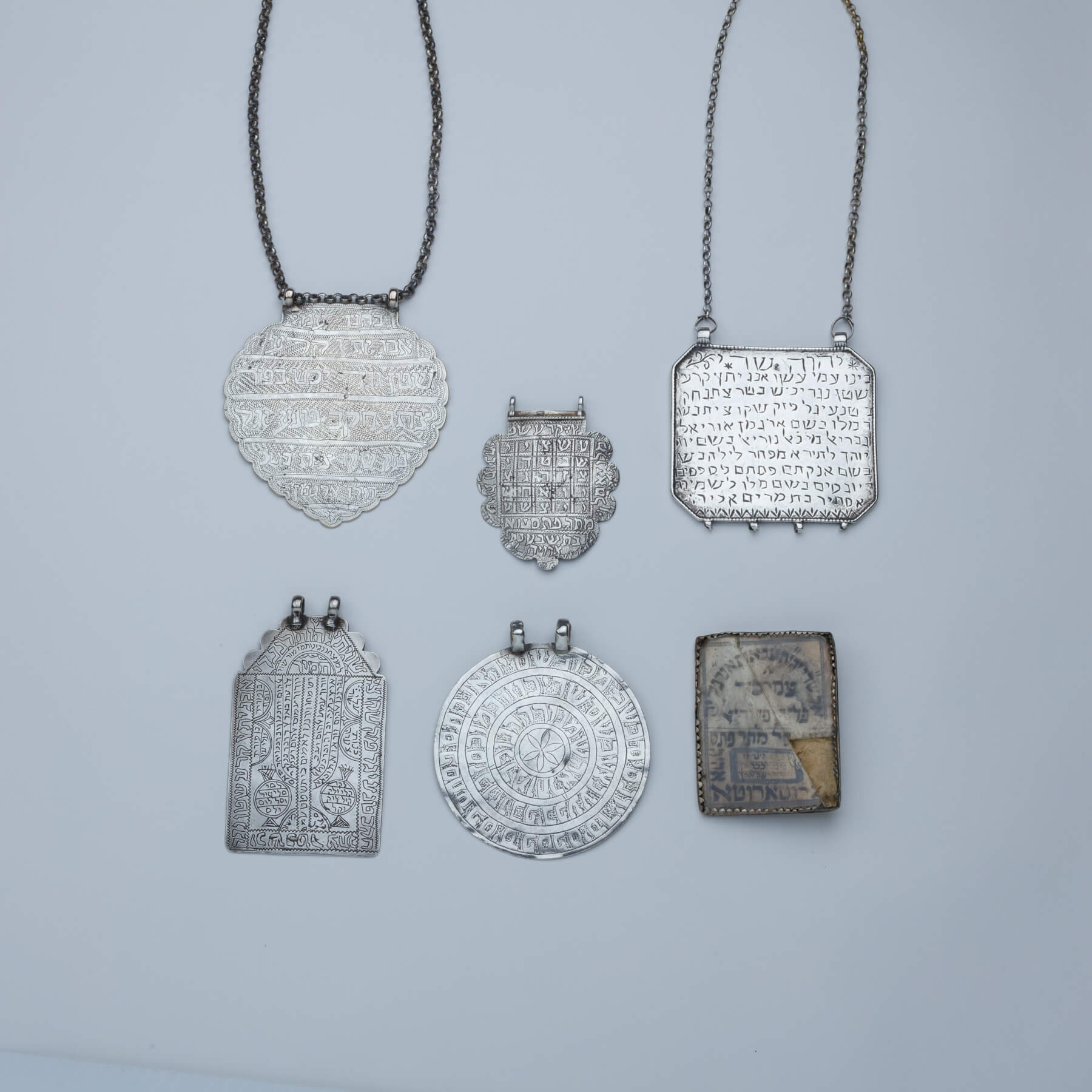 108. A Group of Six Large Silver Amulets