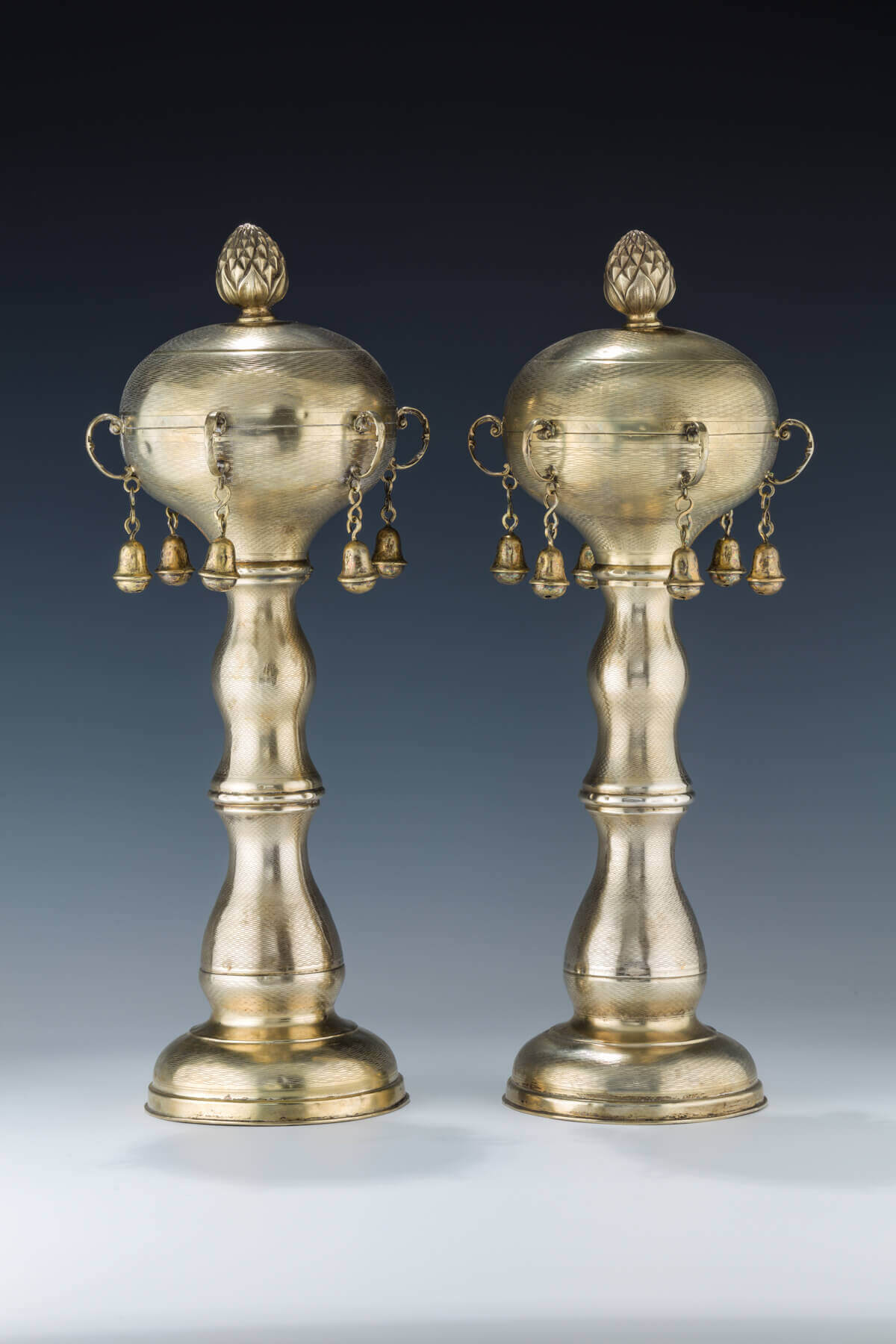 054. A MONUMENTAL PAIR OF GILDED SILVER TORAH FINIALS