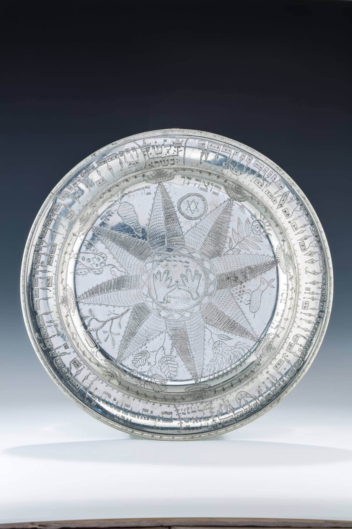 065. A LARGE AND RARE PEWTER SEDER DISH