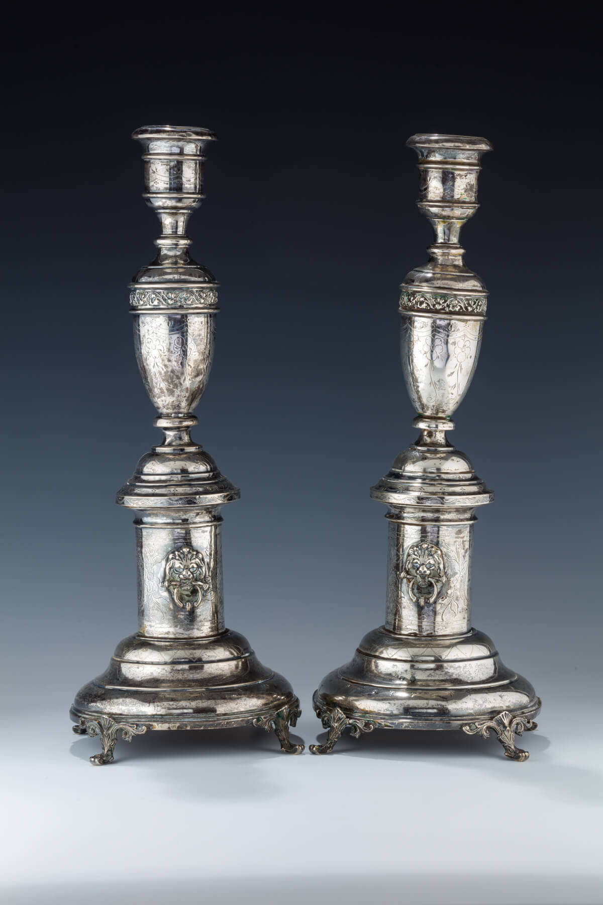 027. A PAIR OF LARGE SILVER CANDLESTICKS