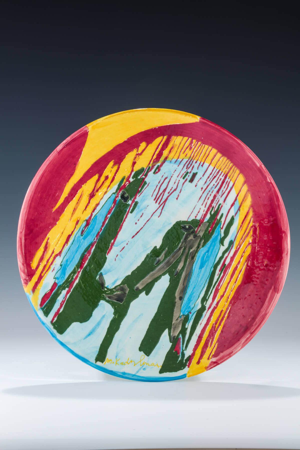 173. A CERAMIC PLATE BY MENASHE KADISHMAN