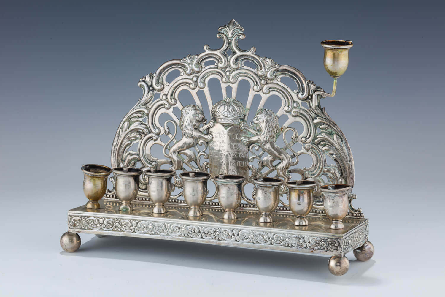 088. AN UNUSUAL SILVER HANUKKAH LAMP