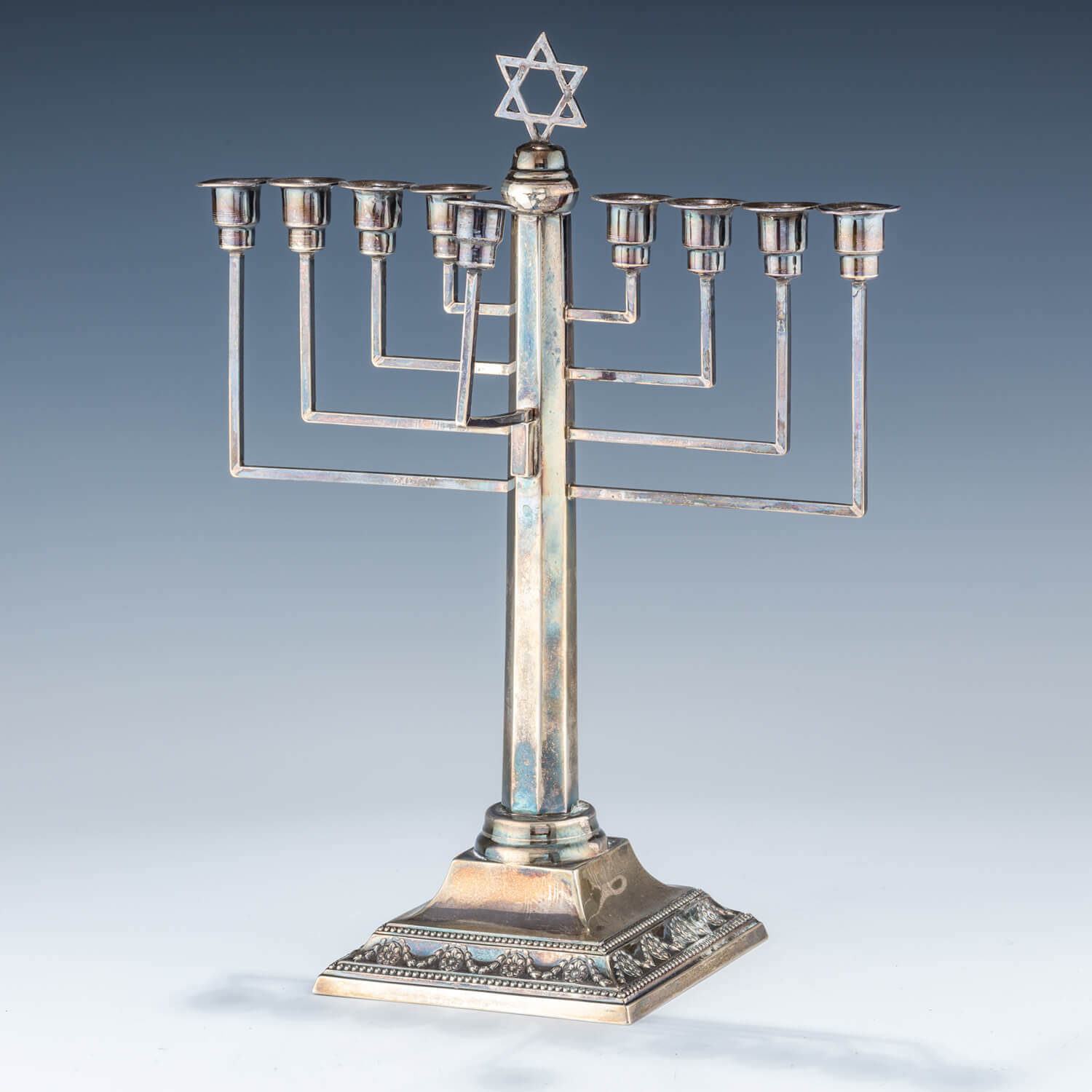 104. A STERLING SILVER HANUKKAH MENORAH BY MORRIS SALKIND