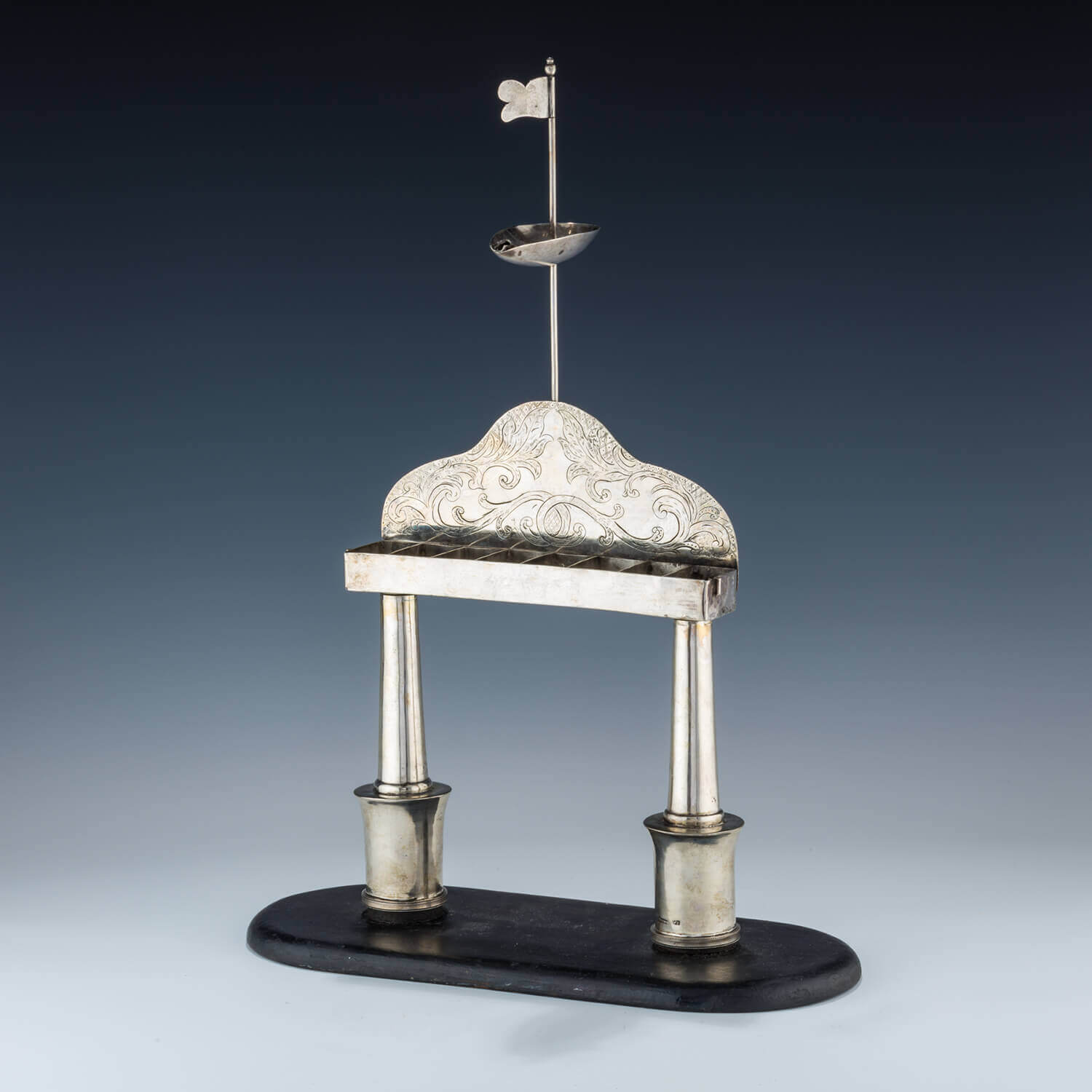 128. A RARE AND IMPORTANT SILVER HANUKKAH MENORAH BY BERGER